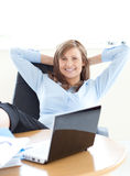 Businesswoman relaxing in the office Royalty Free Stock Photos
