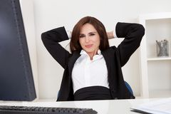 Businesswoman relaxing at the office Stock Photography