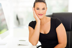 Businesswoman relaxing office Stock Images