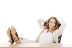 Businesswoman relaxing in office. Stock Photo