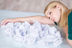 Businesswoman Relaxing With Paper Balls In Front At Desk Stock Photography