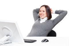 Businesswoman relaxing at workplace Stock Images