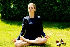Businesswoman relaxing by yoga Royalty Free Stock Photo