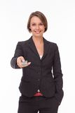 Businesswoman with remote control on white Royalty Free Stock Images