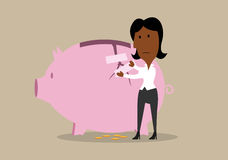 Businesswoman repairing broken piggy bank Royalty Free Stock Images