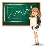 A businesswoman reporting in front of blackboard Stock Photo