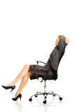 Businesswoman resting on armchair Stock Image