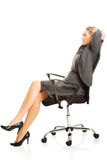 Businesswoman resting on armchair Royalty Free Stock Photo