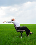 Businesswoman resting on chair Stock Image