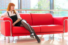 Businesswoman resting on a couch Stock Photography