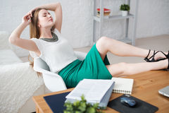Businesswoman resting relaxing legs on the table Stock Images