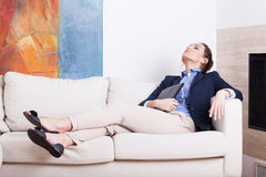Businesswoman resting on sofa after work Stock Photo