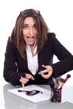 Businesswoman retouches her makeup Royalty Free Stock Photography