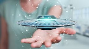 Businesswoman with retro UFO spaceship 3D rendering Royalty Free Stock Photo