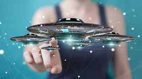 Businesswoman with retro UFO spaceship 3D rendering. Businesswoman on blurred background with retro UFO spaceship 3D rendering Royalty Free Stock Photo