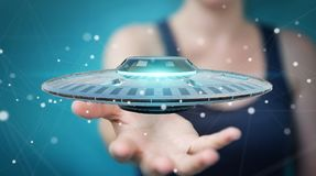 Businesswoman with retro UFO spaceship 3D rendering. Businesswoman on blurred background with retro UFO spaceship 3D rendering Stock Photos