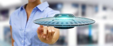 Businesswoman with retro UFO spaceship 3D rendering. Businesswoman on blurred background with retro UFO spaceship 3D rendering Stock Image