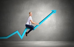 Businesswoman ride graph Royalty Free Stock Images