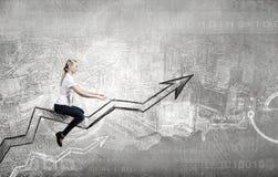 Businesswoman ride graph Stock Photos