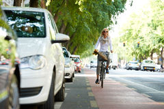 Businesswoman riding bike in the city Stock Image