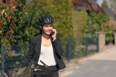 Businesswoman riding to work pausing for a call Royalty Free Stock Photos