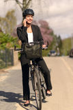 Businesswoman riding to work pausing for a call Stock Images