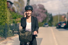 Businesswoman riding to work pausing for a call Stock Photos