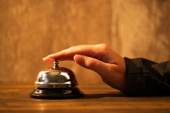 Businesswoman ringing hotel reception bell Royalty Free Stock Photos