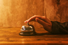 Businesswoman ringing hotel reception bell Stock Images