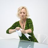 Businesswoman ripping papers Stock Images