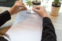 Businesswoman ripping up a contract Stock Photo