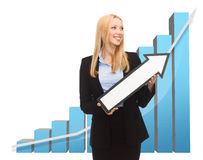 Businesswoman with rising graph and arrow Royalty Free Stock Image