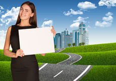 Businesswoman with road leading to business center Stock Images