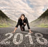 Businesswoman on a road ready for 2018 Royalty Free Stock Photos