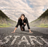 Businesswoman on a road ready to run. Motivation concept Stock Photography
