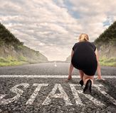 Businesswoman on a road ready to run. Motivation concept Stock Image