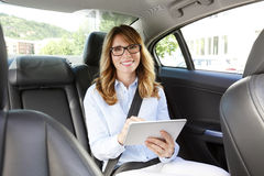 Businesswoman on the road Stock Photography