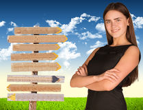 Businesswoman with road sign Stock Image