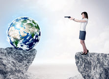 Businesswoman on rock mountain with a globe Royalty Free Stock Images