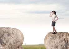 Businesswoman on rock mountain Royalty Free Stock Photography