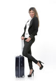 Businesswoman with a rolling suitcase. Stock Images