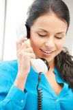 Businesswoman with rotary phone calling Royalty Free Stock Images