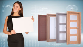 Businesswoman and row wooden doors Royalty Free Stock Photography