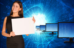 Businesswoman with rows monitors and glowing Royalty Free Stock Image
