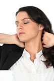 Businesswoman rubbing her neck Royalty Free Stock Photography