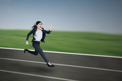 Businesswoman run - outdoor Stock Images