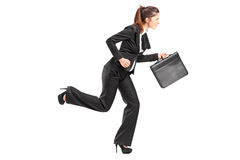 Businesswoman running with a briefcase Stock Photography