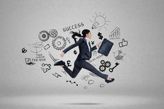 Businesswoman running for chasing her aim Royalty Free Stock Images