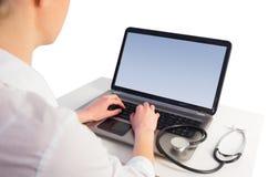 Businesswoman running computer diagnostics Stock Photos
