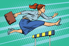 Businesswoman running hurdles Royalty Free Stock Photography